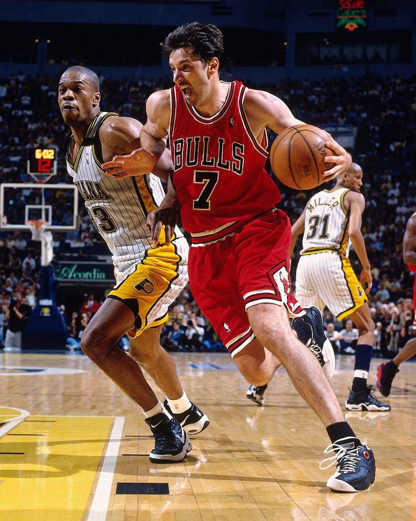 INDIANAPOLIS - MAY 29:  Toni Kukoc #7 of the Chicago Bulls drives to the basket against Antonio Davis #33 of the Indiana Pacers in Game Six of the Eastern Conference Finals during the 1998 NBA Playoffs at Market Square Garden on May 29, 1998 in Indianapolis, Indiana.  The Pacers won 92-89.  NOTE TO USER: User expressly acknowledges that, by downloading and or using this photograph, User is consenting to the terms and conditions of the Getty Images License agreement. Mandatory Copyright Notice: Copyright 1998 NBAE (Photo by Nathaniel S. Butler/NBAE via Getty Images)